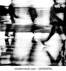 black and white city business people walking