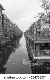 Black and white city view of Amsterdam with water reflection. Capital and most populous city of the Netherlands
