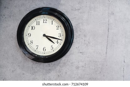 black and white classic wall clock on loft style wall