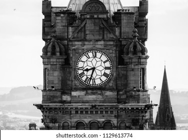 Black and White Clock Face on Tower