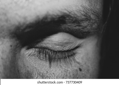black and white close up of a meditating young man with closed eyes
