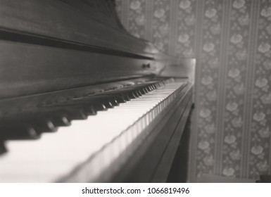Black and white close up of a piano keyboard showing perspective