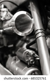Black and white close up shot of custom made motorbike details parts