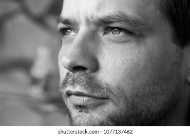 Black and white close up of a young man's face