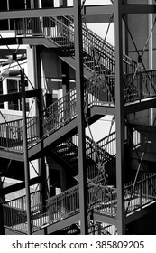 Black and white closeup of a downtown building exterior stairway