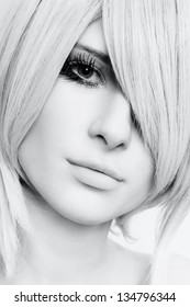 Black and white close-up portrait of young beautiful woman with stylish haircut