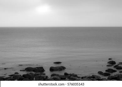 Black and white coastal scene/Calm ocean in black and white