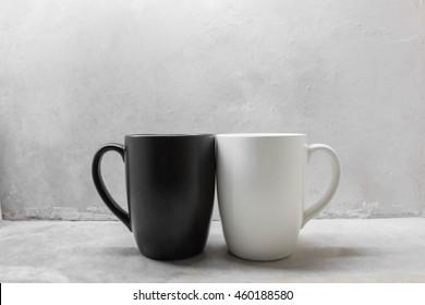 Black and white coffee mug on concrete table