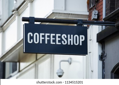 Black and white coffeeshop signboard on dutch bar with legal marijuana sale in city of Amsterdam.Popular tourist attraction for smoking weed legally.Traditional coffee shop in Holland