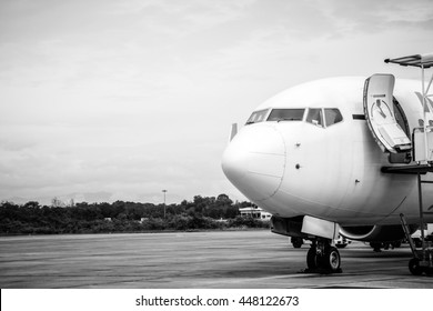Black and white color of airplane in case of emergency landing on runway in the airport