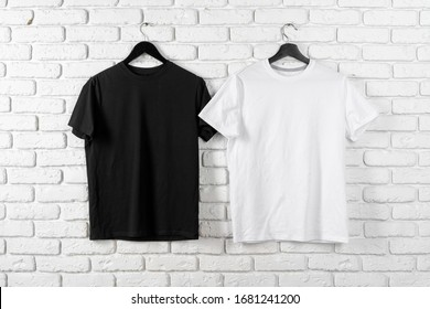Black and white color two plain t-shirts, copy space - Shutterstock ID 1681241200