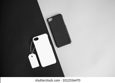 Black and white concept : Top view of mock up clear phone case black and white color with price tag on basic black white background, copy space, branding, corporate