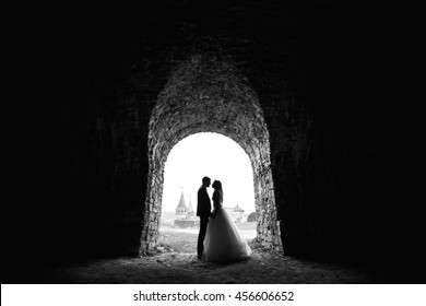 Black and white contour of  bride and groom on background with castle