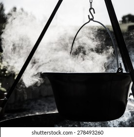 Black White cooking pot over campfire