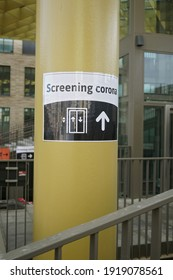 A black and white corona , covid , screening sign at the entrance of a hospital