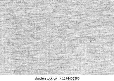 Black and white cotton fabric background. Close up gray cotton fabric texture background.   White textured knit.  Selective focus. top view.