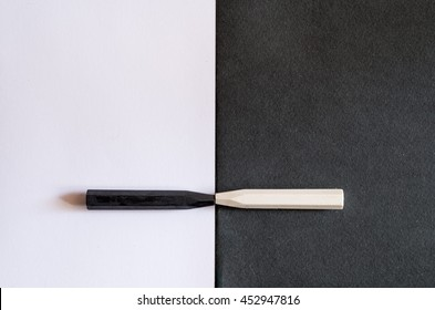 black and white crayons on alternate background of the same color, to symbolize the differences and similarities, tolerance or racism, friendship or hatred