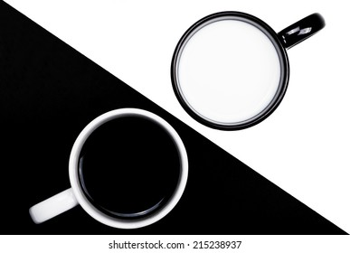 Black and white cups on white and black backgrounds contrasting.