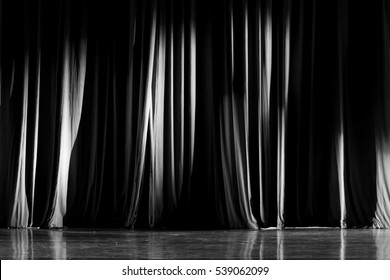 Black and white curtains and spotlight in the Theater between shows.