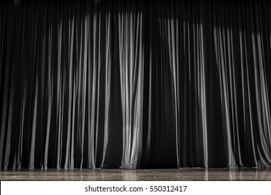 Black and white  curtains and the wooden stage in a theater.