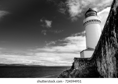Black and white Davaar Island Lighthouse and wall, Campbeltown, Kintyre Peninsula, Scotland