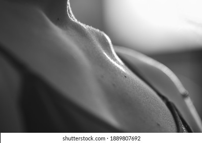 Black and white defocused photo. Naked collarbone. Woman gentle body part. Creative wellness background