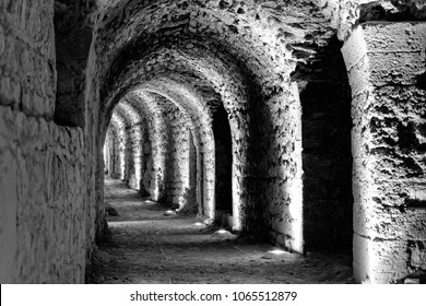 Black and white developed photo of the interior of the castle Karak with electric lights attached for the tourists and visitors, Jordan