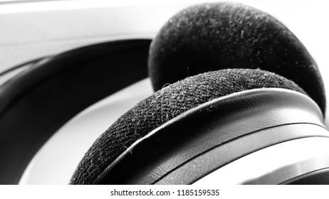 Black and white earphones for music listening   audiophiles