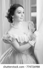 Black and white Elegant woman in historical dress waiting for friends at the ball to dance