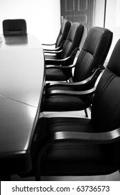 black & white of empty boardroom or meeting room.