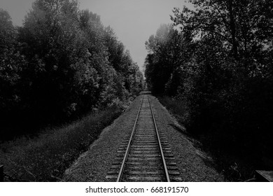 black and white, endless railroad tracks