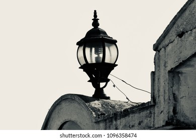 A black and white exterior lights of an old house isolated unique photograph