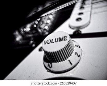 Black and White extreme close up of electric guitar volume knob