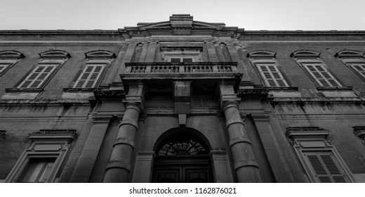 Black and White Facade of Maltese Building, low angle horizontal photography summer 2018