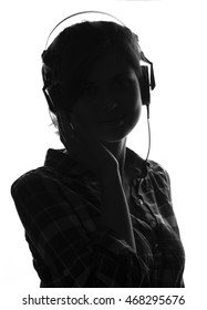 black and white face silhouette of a young beautiful girl listening to music on headphones