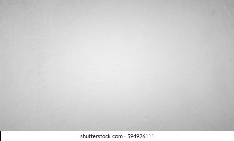 Black and white with faded grey tone background.