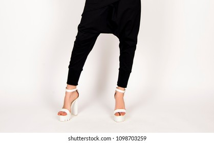 black and white fashion concept, harem pants, white high heels, modern classy stylish business  look, fashion model posing