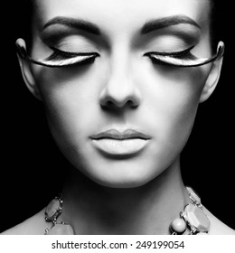 Black and white fashion portrait of beautiful lady with eyelashes