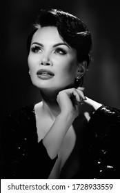 Black white fashion portrait of glamour attractive brunette