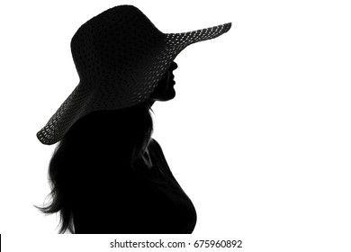 Black and white fashion portrait silhouette of a young woman in a hat with wide brim On white isolated background