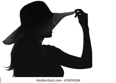 Black and white fashion portrait silhouette of face of a young woman in a hat with wide brim On white isolated background