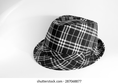 Black and white fedora on a white background
