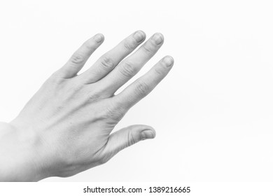 black and white female hand with short nails and neat manicure without varnish on a white background, arthrosis of the joints, normal skin