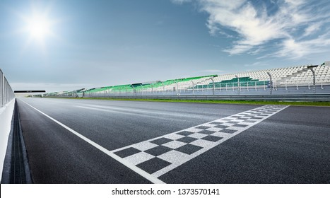 Black and white finish line with dramatic view of a modern race track.