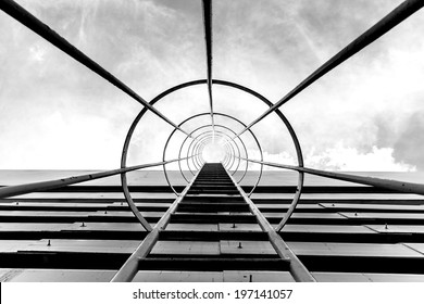 black and white fire escape ladder on a building, iron staircas