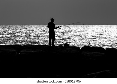 Black and white : Fisherman at the sea