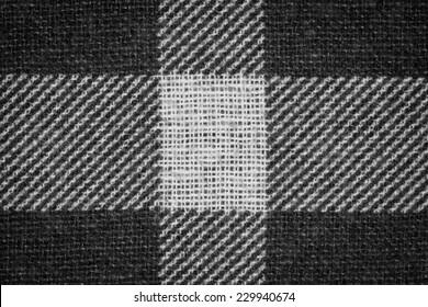 Black and white flannel fabric texture closeup photo background.