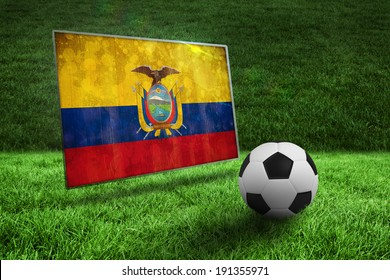 Black and white football on grass against ecuador flag in grunge effect