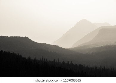 Black and white forest and mountains in smoke from a forest fire