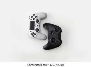 Black and White Game Controllers on white background